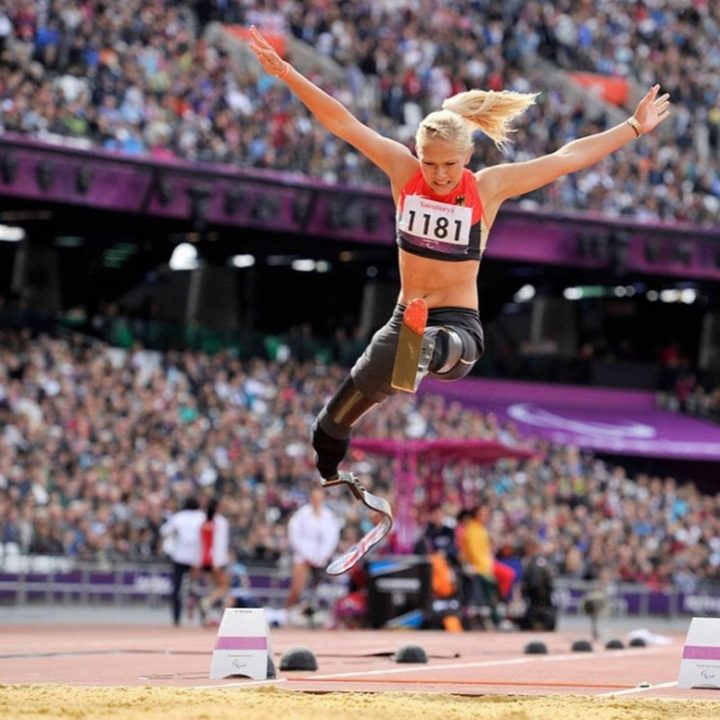Vanessa Low, a 2016 Paralympic champion performing a world record-breaking 4.93-meter long jump.