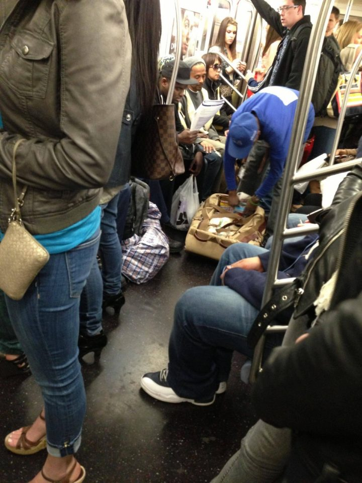 A person that was once homeless now providing sandwiches to people in need in the subway.