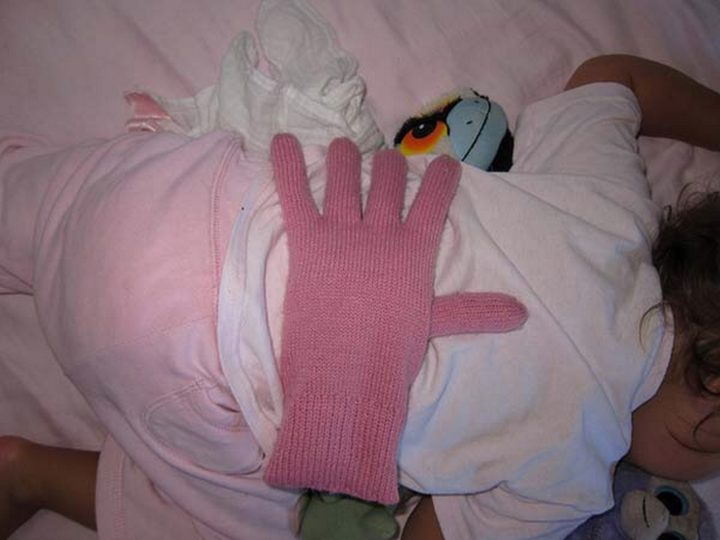 21 Best Mom Hacks - Place a barley or bean filled glove on your baby's back to let them feel loved when you need to step out of the room for a while.