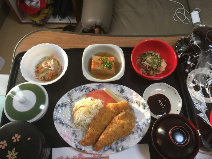 Chicken fingers with shredded cabbage salad, bitter melon stir fry, agedashi tofu, carrot salad, rice, and miso soup.