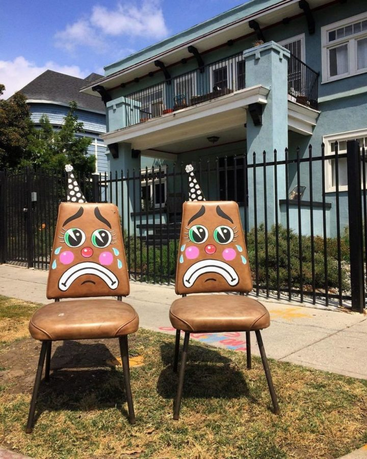 Sad twin chairs waiting to be ripped away from one another.