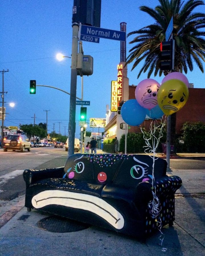 Sad couch with sad balloons.