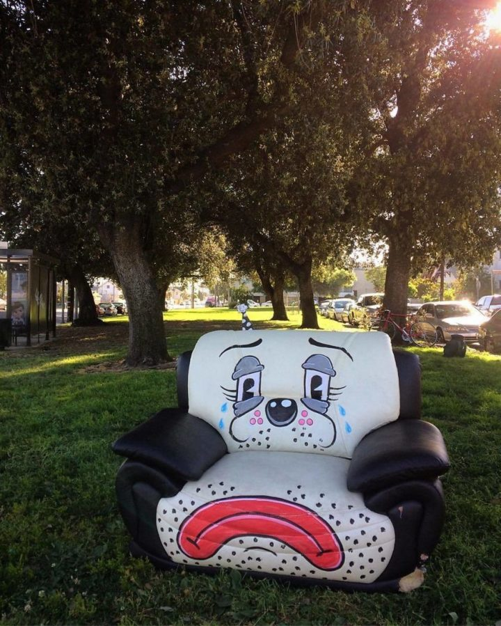 This sad chair looks like a big sad panda.