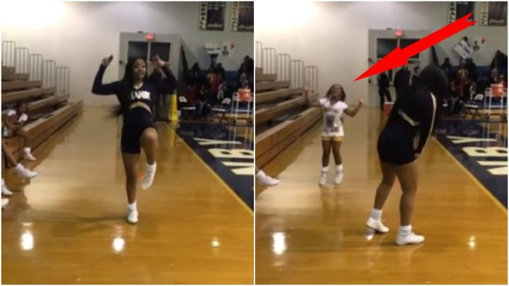 Little Girl Joins in on Her Big Sister's Cheer Solo and It's Priceless.