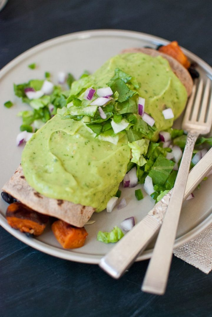 25 Healthy and Delicious Vegetarian Recipes - Sweet Potato Burrito Smothered in Avocado Salsa Verde.
