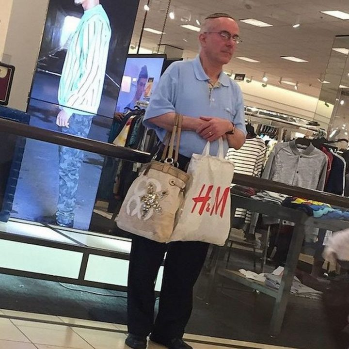 Miserable Men - Relationship Level 9000: Holding your wife's purse while she shops.