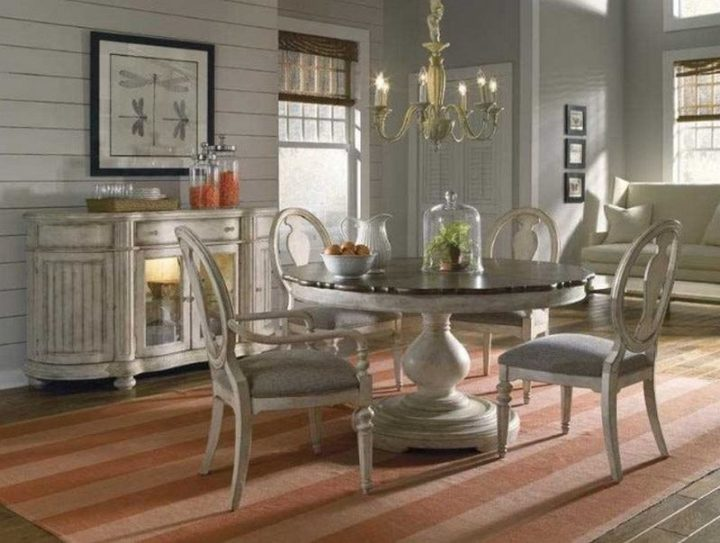Round dining table with wooden top.