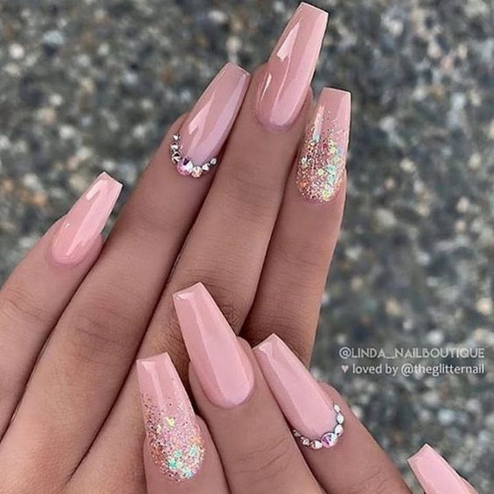 Gorgeous mauve-nude long coffin nails with glitter ombré and crystals.