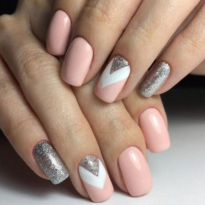 White, pink, and silver come together to create a spectacular manicure.