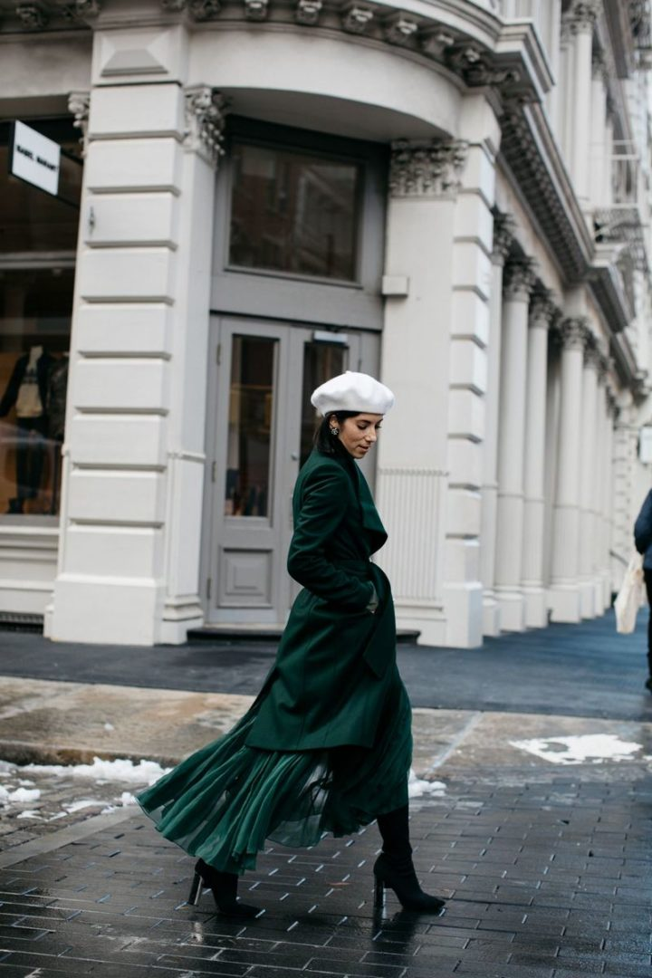 Wear jewel tones like blogger Krystal Blick by using them as a statement piece, layering an emerald coat over the rest of her outfit.