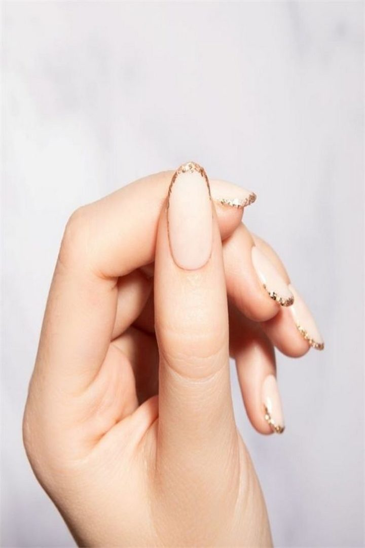Stunning golden nails with a touch of glitter.