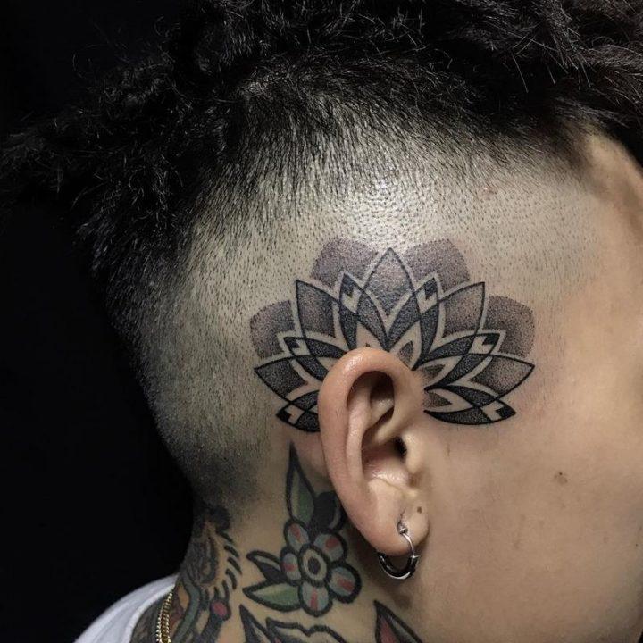 A unique ear tattoo.