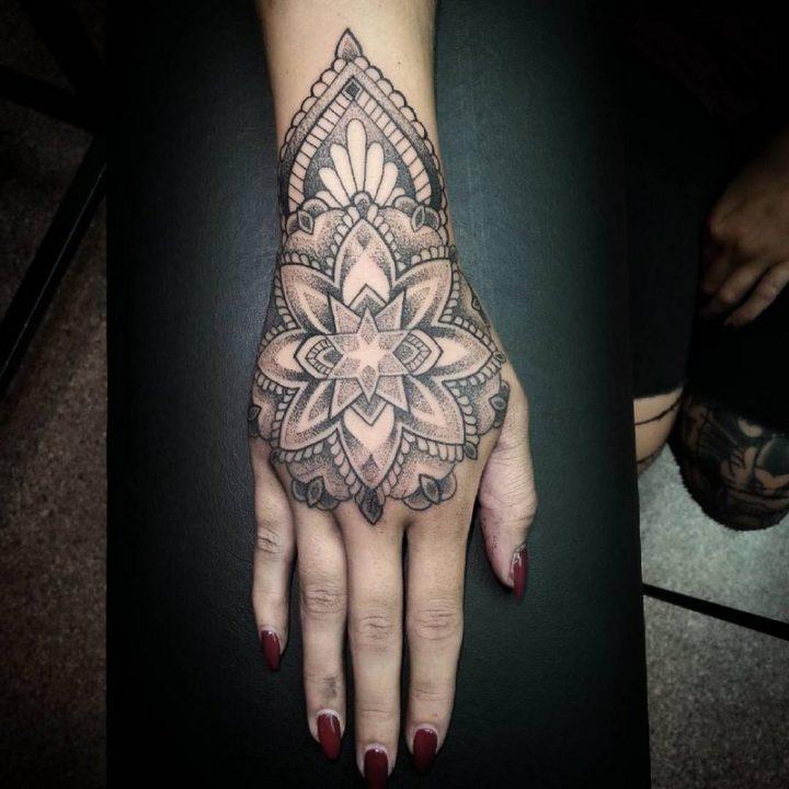 Beautiful and mystical mandala hand tattoo.