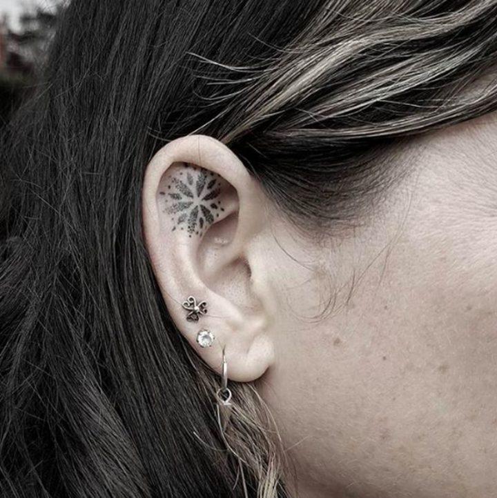 A cute in-ear tattoo.