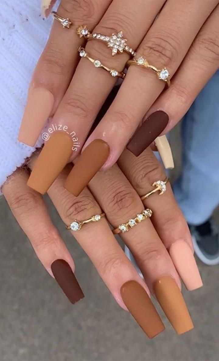 Gradient Brown Nail Design.