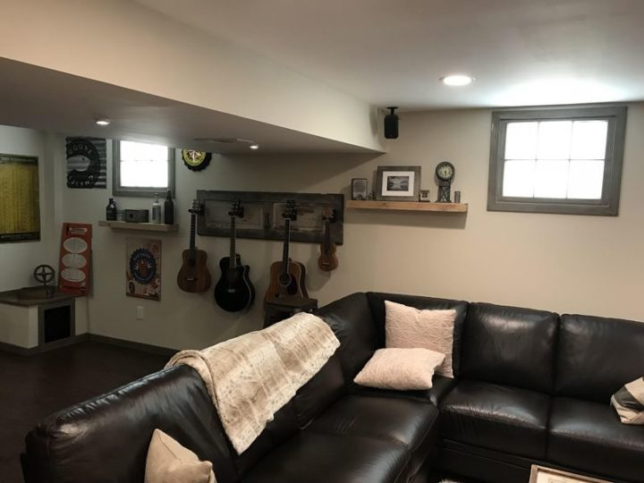 """27 Astonishing Life Hacks - """"I wanted natural light in a basement that has no windows. Paid $10 for two old windows. Painted them, frosted the glass, installed them into my wall with 12"""" LED flat panel lights behind them. Now it's always 2pm at the basement bar."""""""