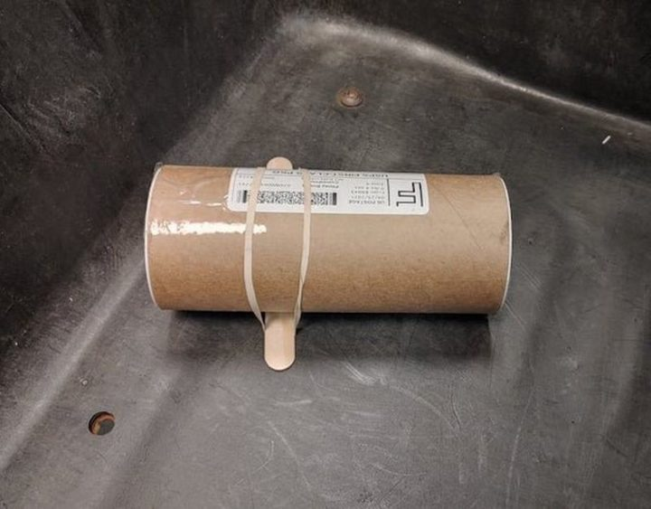 """""""A customer mailed this tube with a tongue depressor attached to it to prevent it from rolling around."""""""